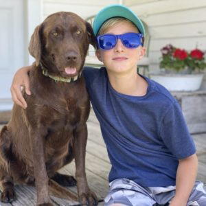Blue Sunglasses to help with mood picture of boy with dog
