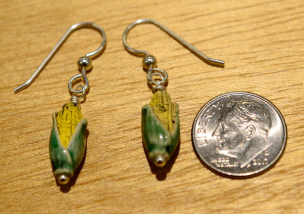 corn earrings with dime for scale
