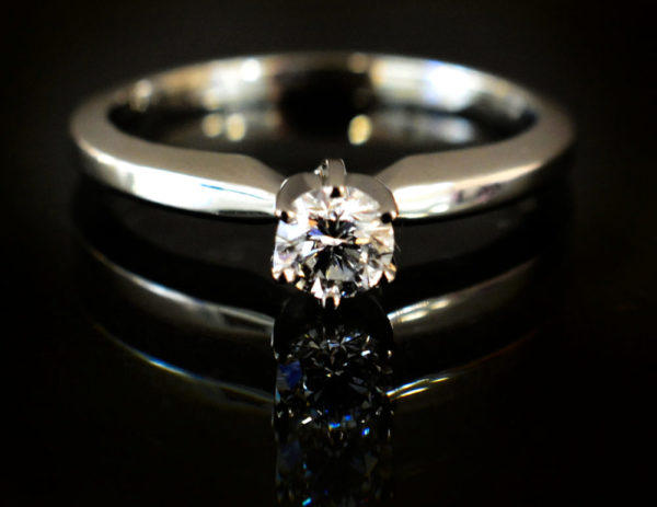 diamond solitaire and 14k white gold engagement ring