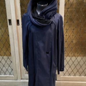 photo of Navy blue reversible to black pleated hood raincoat