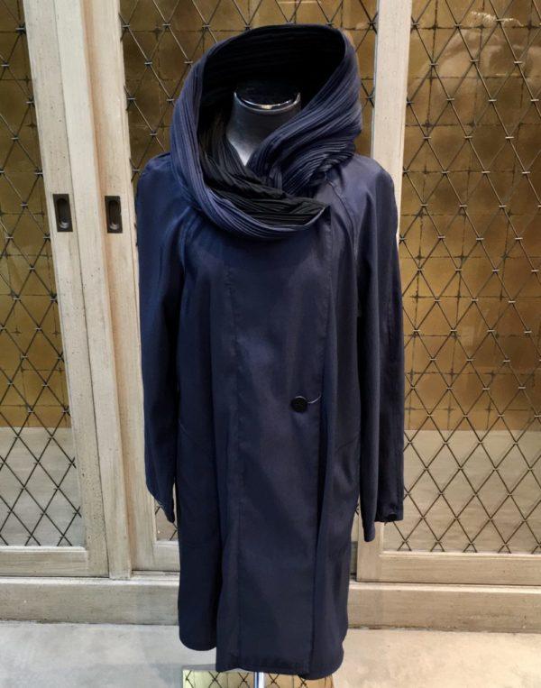 photo of Navy blue reversible to black pleated hood raincoat