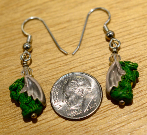 ceramic dragon earrings with dime for scale