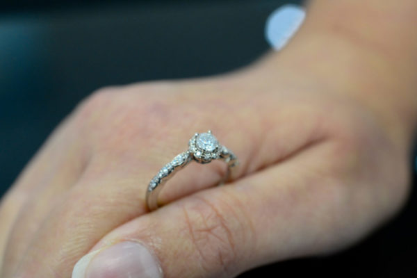 diamond and 14K white gold halo style engagement ring