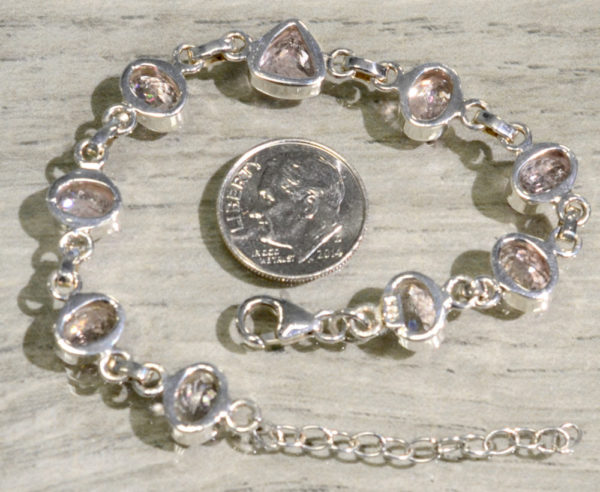back of morganite bracelet with dime for scale