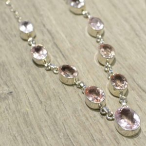 close-up of faceted morganite gemstone and sterling silver necklace