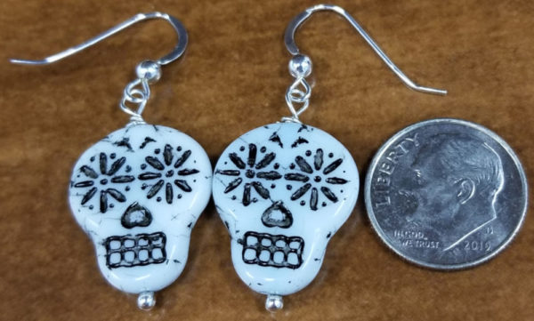 dime for scale next to sugar skull earrings