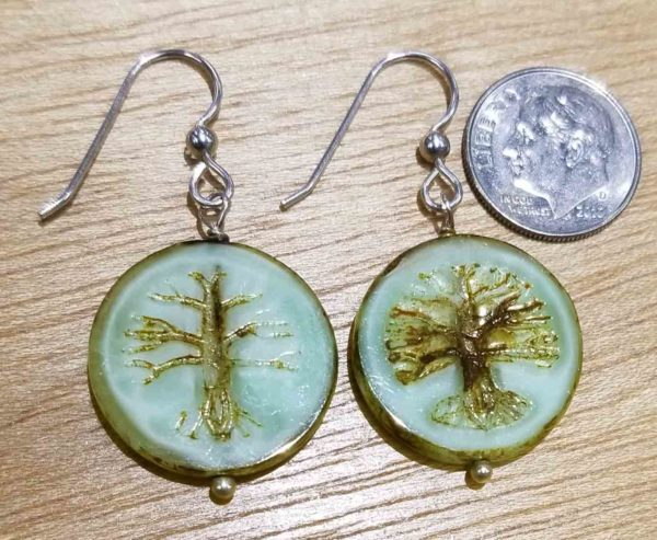back of tree earrings with dime shown for scale