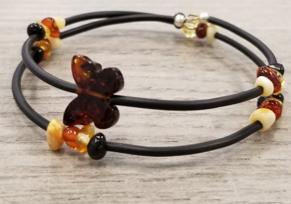 This Baltic amber bracelet features a butterfly shaped amber bead and multicolor amber nuggets.