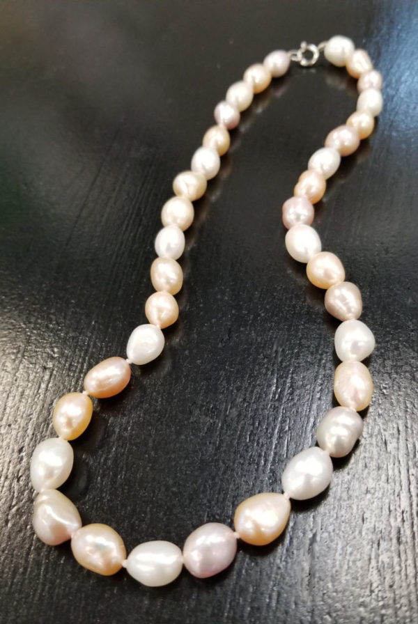baroque shape fresh water pearl necklace features white pearls, natural champagne color, and pink natural color pearls