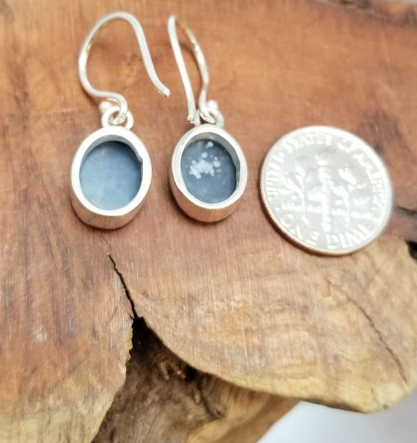 back of black quartz druzy and sterling silver earrings with dime for scale