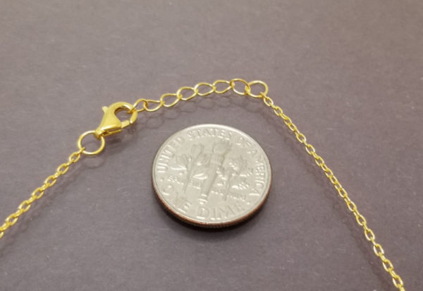 this necklace is adjustable, please note the dime for scale