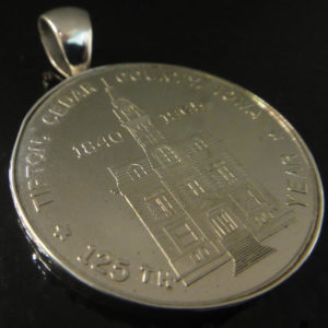 Tipton Iowa Souvenir coin pendant set in silver