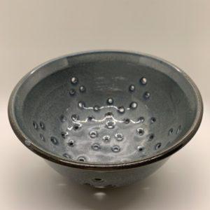 Blue glazed ceramic strainer