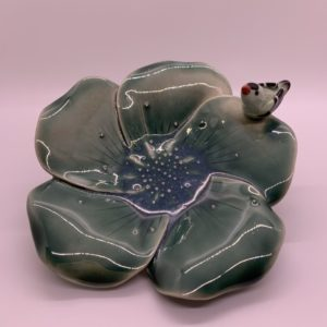 Hand-made green ceramic bowl with bird attached