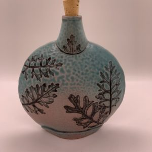 Ceramic flask with cork, stamped and carved