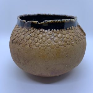 Raw ceramic rounded base vessel with texture