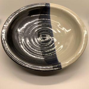 Black and cream glazed ceramic serving dish