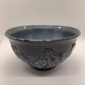 Blue glazed ceramic bowl, carved and stamped for decoration