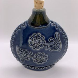 Ceramic flask with cork, stamped and carved for decoration