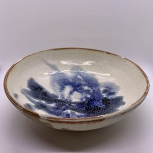 Blue and cream painted ceramic serving dish
