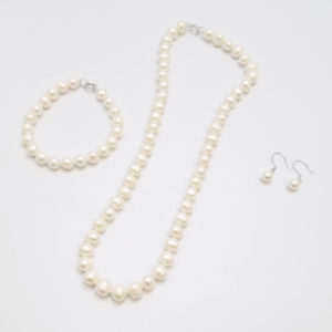 pearl jewelry set including a necklace, bracelet, and drop earrings