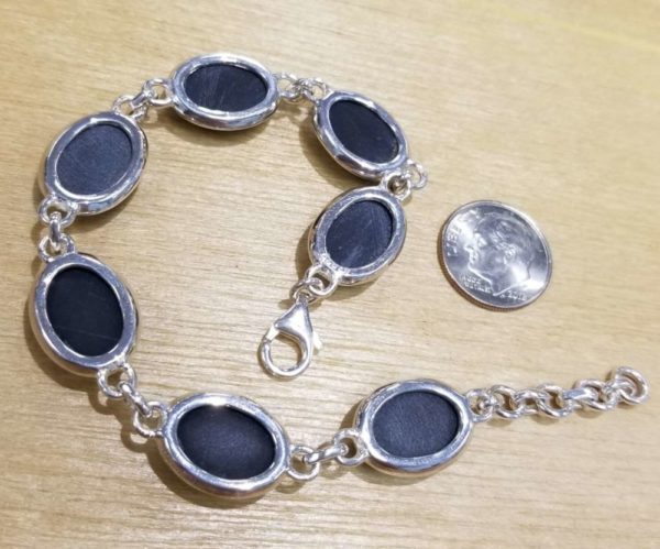 back of black onyx bracelet with dime to help judge scale