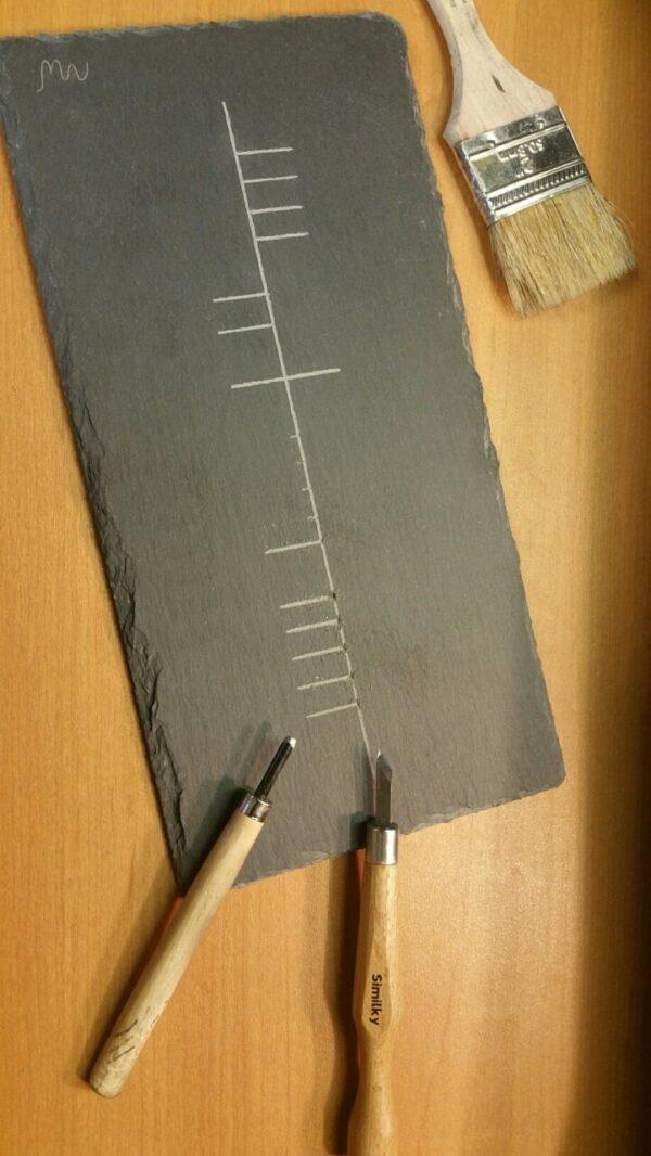 Carved Slate in Irish Language by Mark Weiser