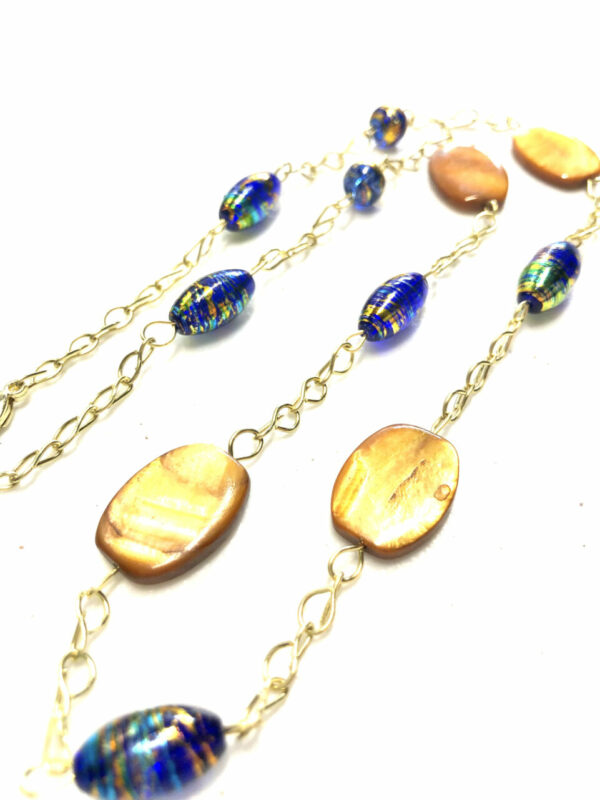 Blue, tan & gold colored women's necklace