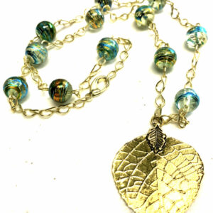 Women's handmade glass beaded necklace with leaf pendant