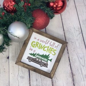 In A World Full of Grinches Be A Griswold Farmhouse Mini Sign